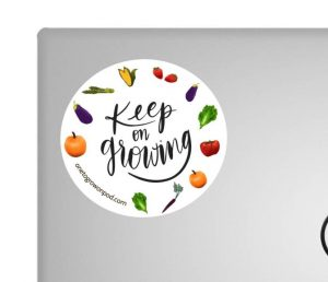 Keep On Growing sticker superimposed on a laptop case