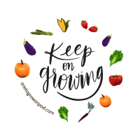 """keep on growing"" in script surrounded by vegetables"